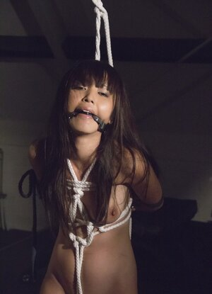 Adorable broad from Japan tied up by guy who pours wax on her slim body