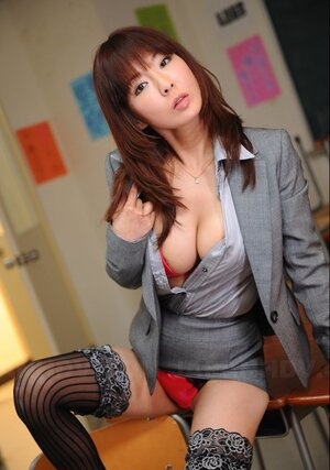 Oriental businesswoman wears likewise hot stockings and red lingerie under office outfit