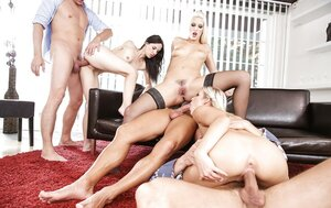 Excited gals suck and get their asses penetrated in backdoor orgy scene