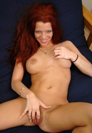 Redhead with bettered tits takes glass dildo to bring herself to orgasm