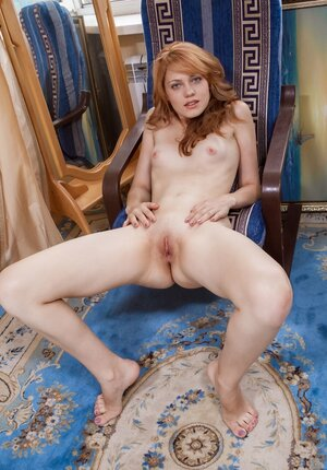 Outstanding redhead porn model removes shirt and denim shorts in her room