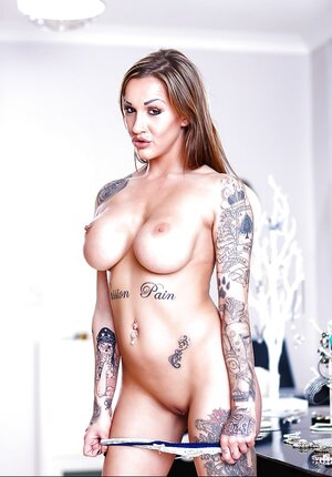 Sexually available mom in blue has tattooed body that must be showed off worldwide in Fully hardcore photos
