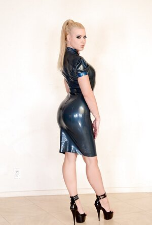 Arrogant latex femdom goddess helps her sexy pet in fishnets to pose on a leash