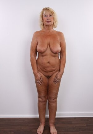 Aged diva shamelessly shows off saggy natural breasts and additionally unshaved vag