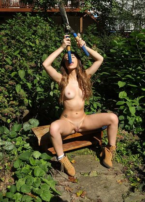 Minx with Monroe and additionally navel piercing takes gardener's hand additionally pruners to wank