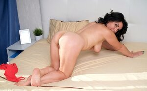 Bad female in red underwear sleeps naked so she strips and furthermore masturbates a bit