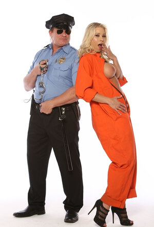 Tricky blonde inmate unzips orange uniform to lower prison warden's guard