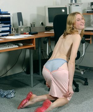 Sinful worker undresses in office exposing gigantic boobs and also trimmed vagina