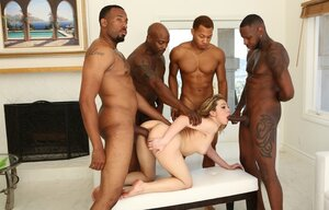 Hungry bitch dragged into interracial gangbang sex with four Ebony stallions