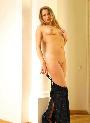 Relaxed blonde takes off black dress and additionally finally frees her natural boobs