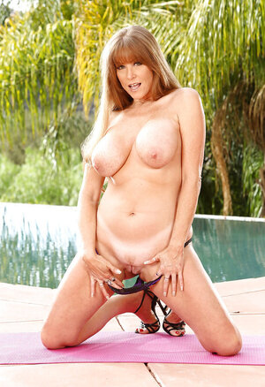 Sultry Soccer mom gives a sinful massage to own muff poolside upon request by cameraman