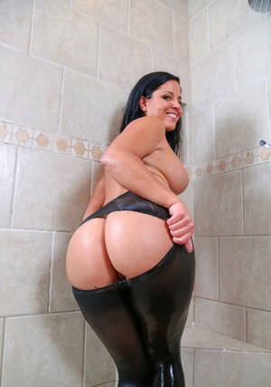 Joyful bombshell relaxes in shower with sizeable tush exposed out of ripped leggings